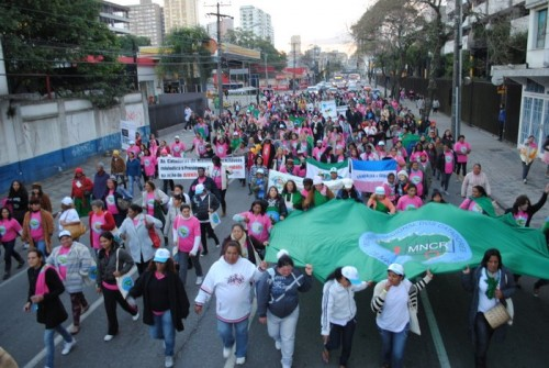 women waste pickers march through streets of curitiba