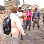 Dandora Waste pickers' Secretary Julius Gitua shares a point with Elaine. Photo credit: Evalyne Wanyama.