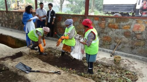 SHG members engaged in the process of composting