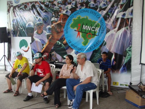 Leaders of MNCR and Streetnet International at the MNCR panel. Maíra Vannuchi, middle right.
