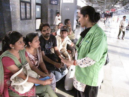 Chintan members explaining to passengers what its work is about. Photo credit: Chintan.