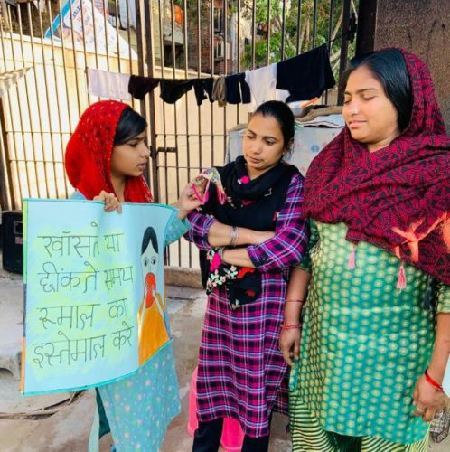 Roshini student of Chintan Nizamuddin learning center spreading awareness among the members of community on importance of using hankie to protect oneself from coronavirus.